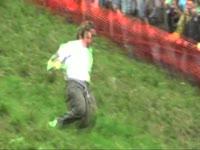 Guy Tumbles Downhill