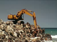Tagged Videos: Excavator on Beach